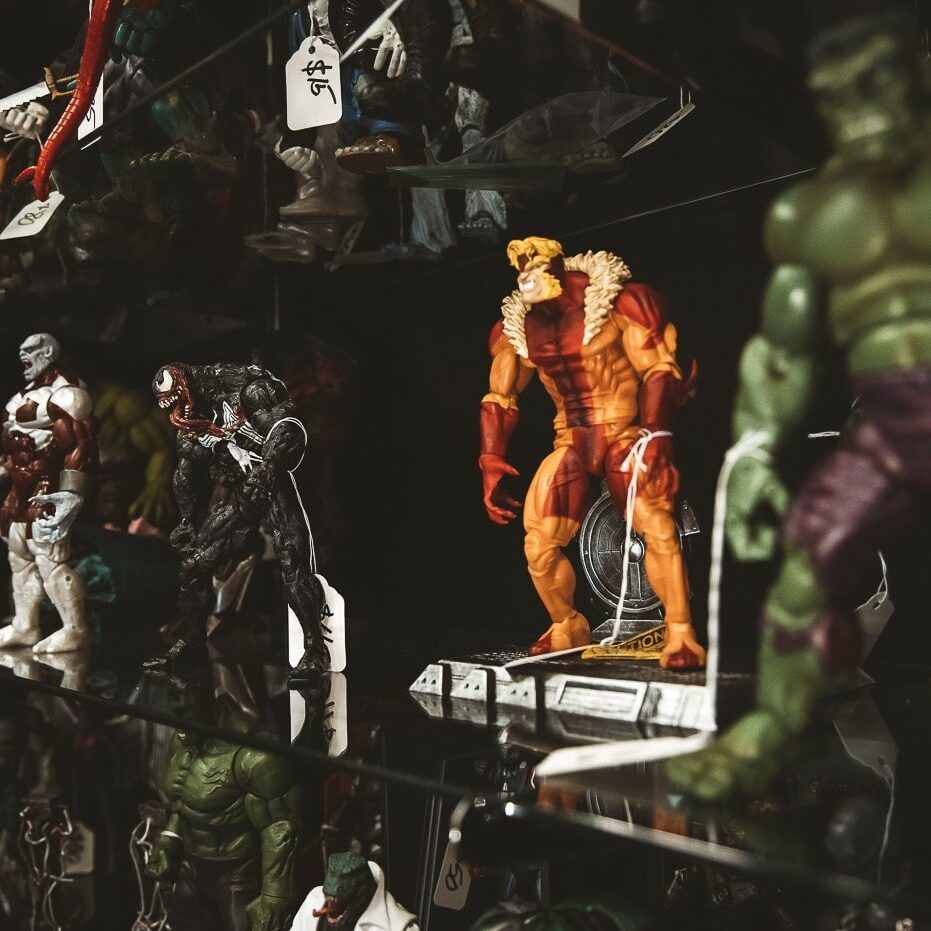 Glass case with Marvel and DC character figurines